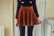 03 a mustard velvet mini skirt, a black sheer blouse over a top, black tights and booties