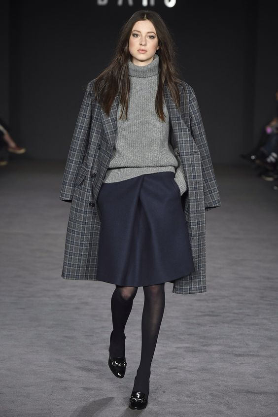 a navy over the knee skirt, a grey turtleneck sweater, black tights, vintage-inspired shoes and a checked coat for work