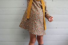 03 a vintage-inspired printed floral dress, a mustard scarf, grey socks and boots