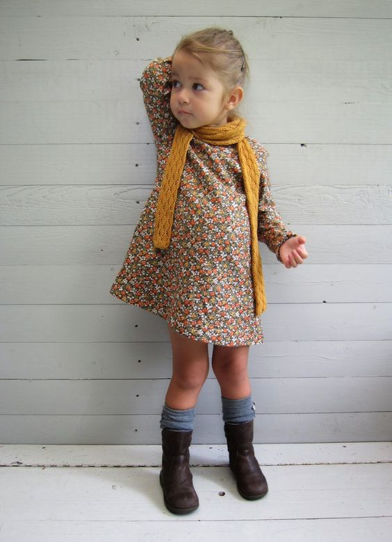 a vintage-inspired printed floral dress, a mustard scarf, grey socks and boots