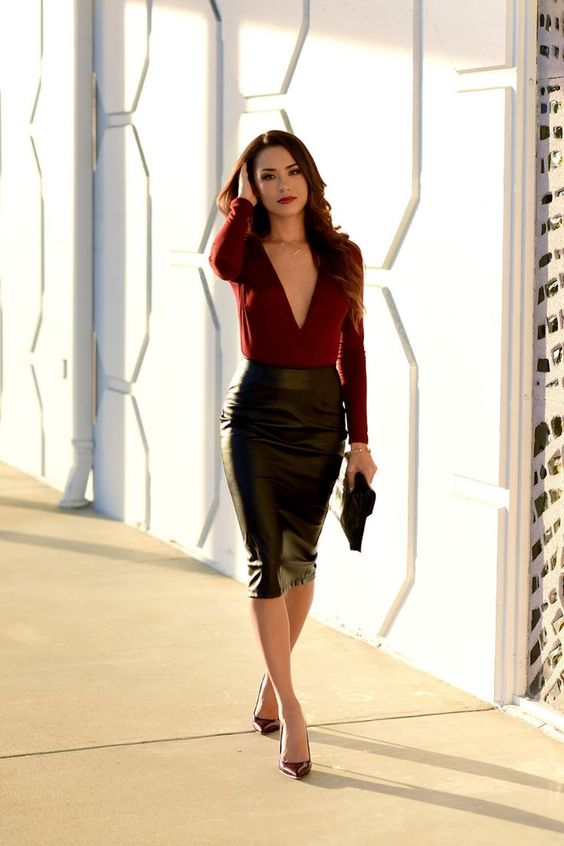 a black leather midi, a burgundy plunging neckline top and matching heels for a date