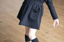 04 a black long sleeve dress, a black beret, black socks and white leather boots