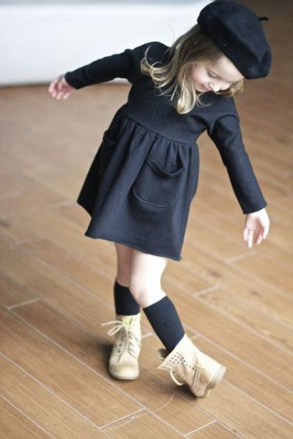 a black long sleeve dress, a black beret, black socks and white leather boots