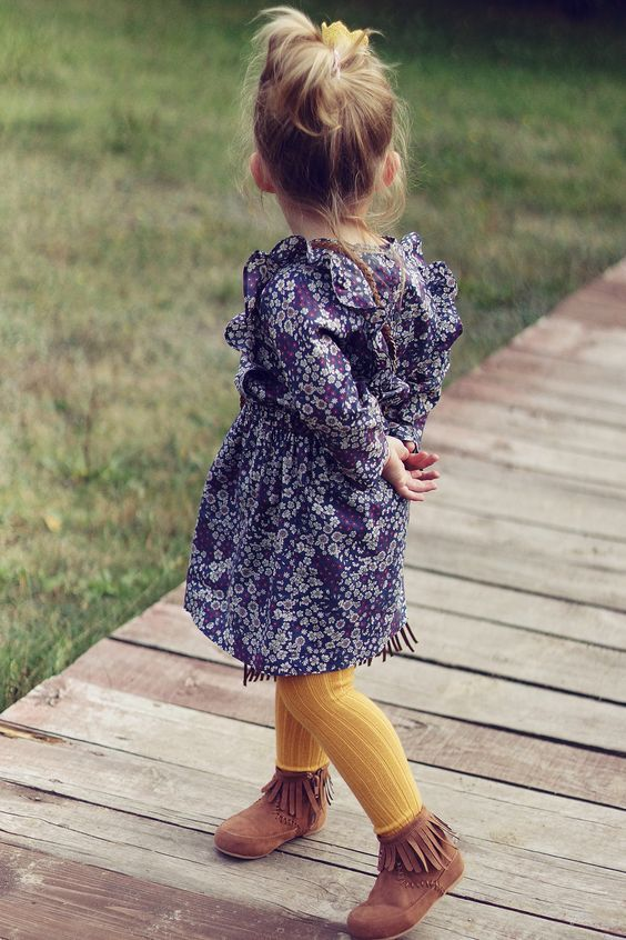 a chiffon purple and white floral dress, yellow warm tights and leather fringed shoes