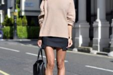 04 a chunky beige sweater, a black mini skirt, black leather booties and a bag