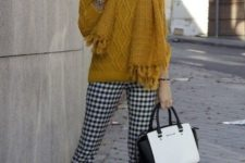 04 a mustard sweater and scarf, checked black and white pants and mustard shoes