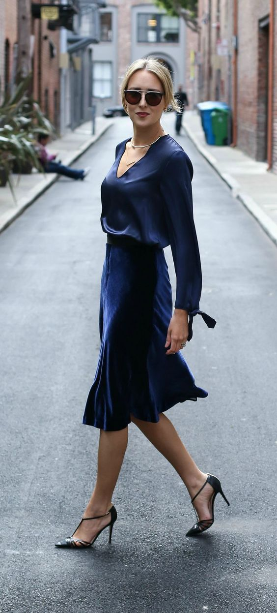 a navy silk blouse, a navy velvet midi skirt and black vintage-inspired shoes
