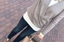 04 a white long sleeve top, a grey sweater over it, a statement necklace, navy jeans and grey suede booties