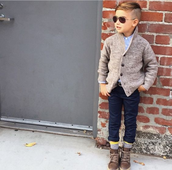stylish fall boy's look with navy pants, grey sorcks, brown suede boots, a blue shirt and a neutral cardigan