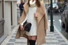 04 thigh high black suede boots, a white sweater dress, a caeml coat and a black bag