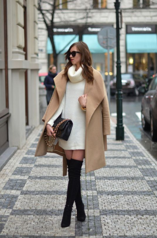 thigh high black suede boots, a white sweater dress, a caeml coat and a black bag
