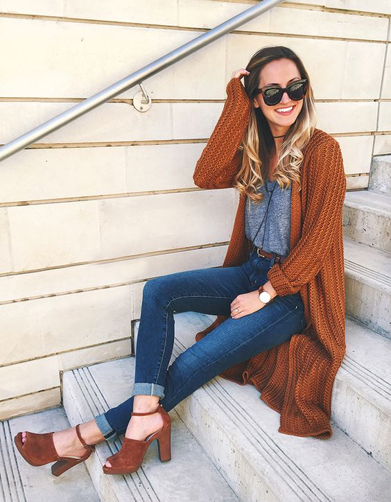 a comfy long burnt orange cardigan, a grey top, blue cuffed jeans and burnt orange shoes