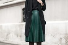 05 a green midi pleated skirt, a black top, a black coat and brown suede boots