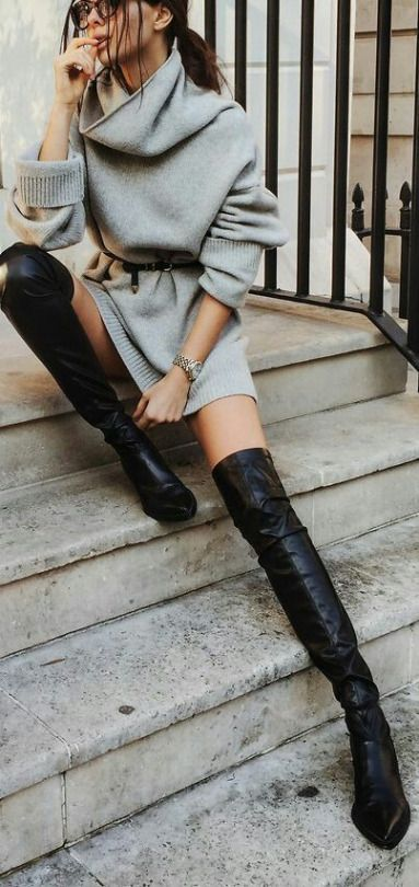 a grey sweater dress with a leather belt on the waist, black leather tall boots for a fall to winter look