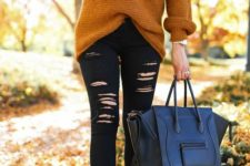 05 a mustard V-neckline sweater, black ripped denim, black suede boots and a black bag