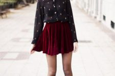 05 a red velvet mini pleated skirt, a black sheer shirt with a print, black tights and black boots