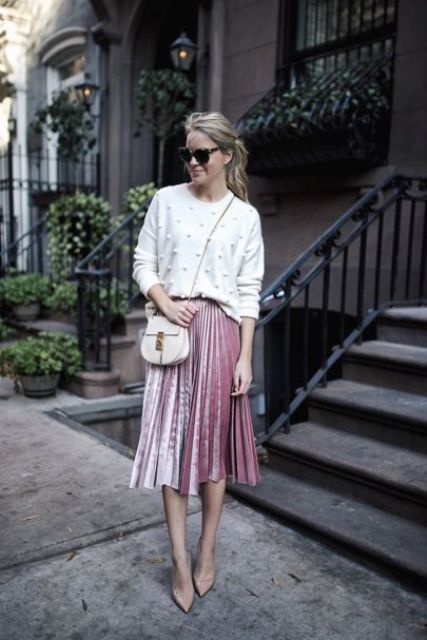 a white pearly sweater, a pink pleated velvet midi skirt, nude shoes and a white bag