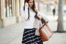 05 a white turtleneck, a checked black and white skirt, brown rider boots and a matching bag