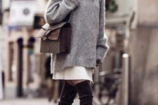 05 an oversized grey sweater over a white mini skirt, dark brown suede tall boots and a brown bag