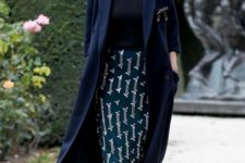 06 a black turtleneck top, a printed teal knee pencil skirt, black shoes and a navy half sleeve coat