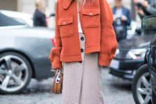 06 a checked wrap midi skirt with buttons, a white top, an orange short coat and creamy boots