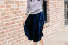 06 a grey top, a navy pleated midi skirt, grey shoes for a girlish look