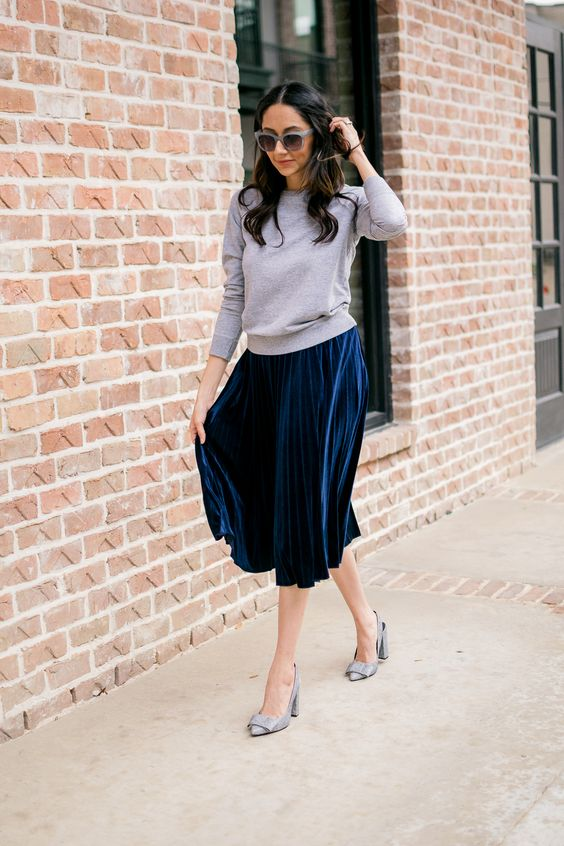 a grey top, a navy pleated midi skirt, grey shoes for a girlish look