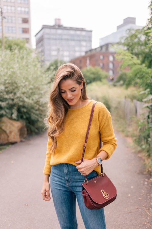 a mustard sweater, blue denim and a vintage burgundy bag for a cool fall look