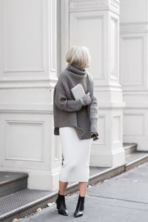 a white straight skirt, a grey oversized sweater, black sock booties