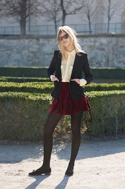 an ivory shirt, a red velvet mini skirt, black tights, a black blazer and black flats for work