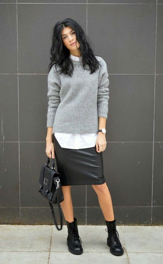 a black leather knee skirt, a grey sweater, a white shirt, black boots and a bag for a creative job