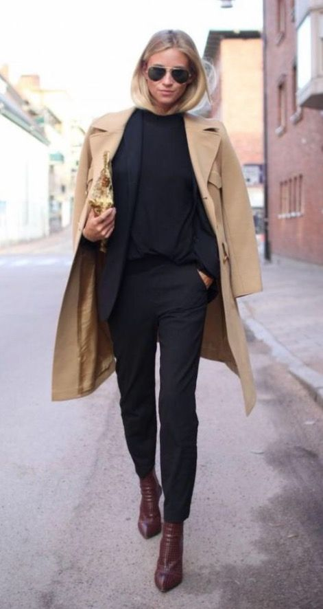 a black pantsuit, a black top, burgundy booties and a camel coat is an ideal fall look