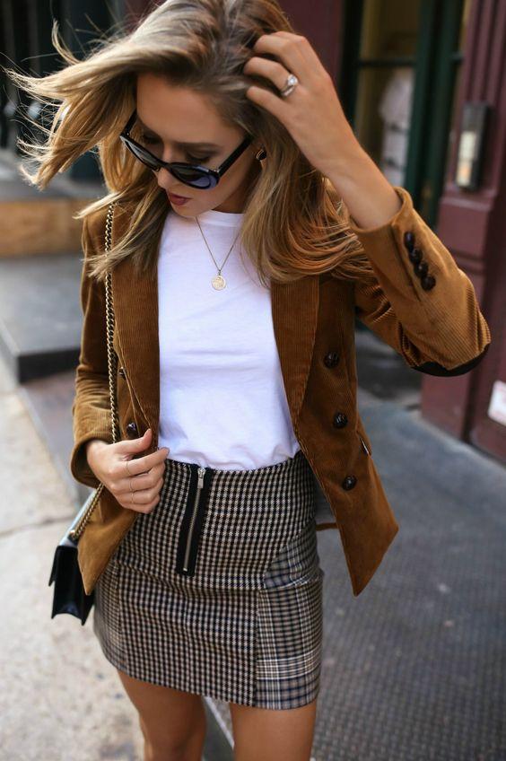 a checked mini skirt, a white tee, an ocher velvetine jacket