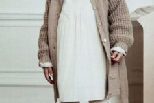 07 a creamy dress, a beige chunky knit cardigan, white tights, brown suede booties