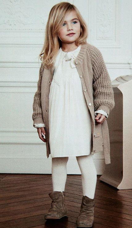 a creamy dress, a beige chunky knit cardigan, white tights, brown suede booties