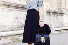 07 a navy velvet skirt, an oversized grey sweater, plum-colored sock booties, a black bag