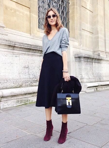 a navy velvet skirt, an oversized grey sweater, plum-colored sock booties, a black bag