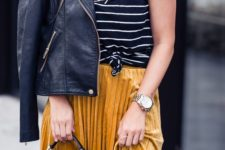 07 a striped black and white tee, a yellow pleated velvet midi skirt, a black leather jacket and a black bag