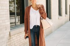 07 blue skinnies, a white tee, grey suede booties, a burnt orange cardigan for a comfy look
