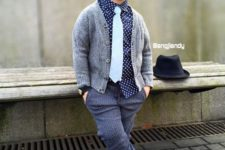 07 striped pants, a polka dot shirt, a white tie, a warm grey cardigan and navy slipons