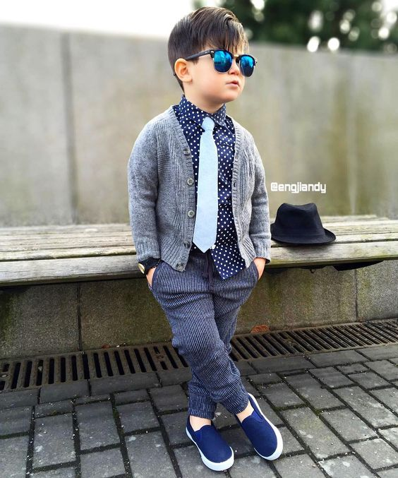 striped pants, a polka dot shirt, a white tie, a warm grey cardigan and navy slipons
