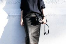 08 a black leather midi, black leather boots, a navy slouchy sweater and a black bag