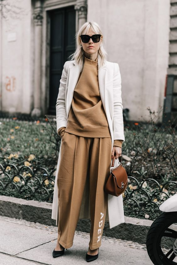 a camel suit, a white coat over it and black heels for a chic fall inspired outfit