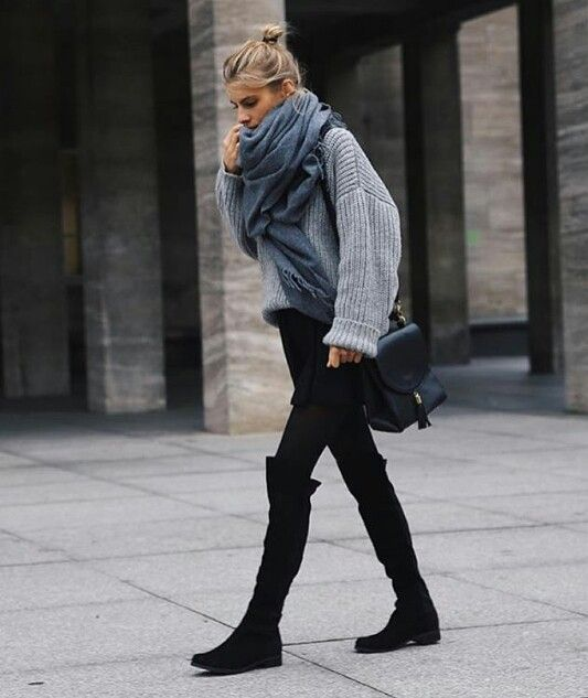 a grey oversized sweater, a black skater skirt, black tights, black suede boots and a scarf