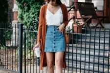 08 a white V-neckline top, a denim skirt with a button row, a long burnt orange cardigan and black leather shoes