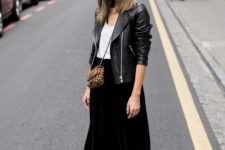 08 a white top, a black midi skirt, a black leather jacket and black Converse