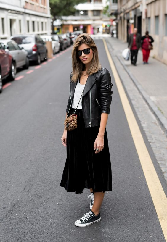 a white top, a black midi skirt, a black leather jacket and black Converse