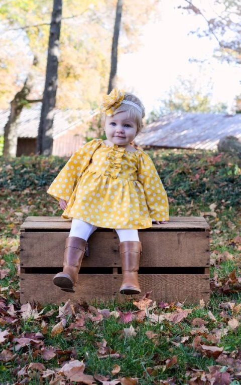 yellow polka dot dress, white tights and brown leather tall boots for a vintage-inspired look