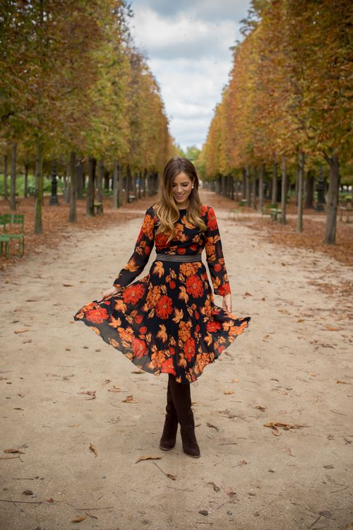 a fall colored floral dress with long sleeves and brown suede tall boots   nothign else is needed