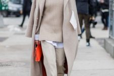 09 neutral pants, a blush sweater over a white shirt, a neutral coat and brown sock boots